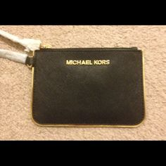 "FLASH SALE!! NWOT Michael Kors black wristlet FLASH SALE!!! Get this gorgeous wristlet for $50 for 1 hour only!!!!!!  NWOT Michael Kors specchio small black wristlet.  Approx 6"" in length & 4"" in height Michael Kors Bags"