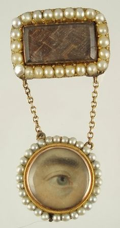 1820 brooch with hair and a lover's eye.