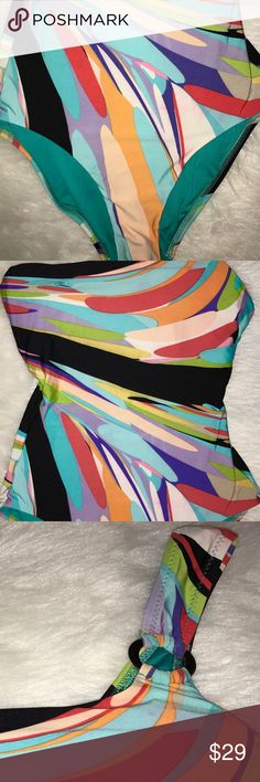"""Trina Turk One Shoulder Multicolor  Prisma Suit Trina Turk Multi Color Printed One-Shoulder Swimsuit size 6 Fits well size 4-6 Worn a bit but still in great shape Very Flattering  Trina Turk one-piece swimsuit  One-shoulder neckline with silver ring. Classic silhouette. Open back on the top, full coverage of torso back and front Full seat coverage. Nylon/spandex; hand wash. Imported. Last photo of a Model's measurements: Height 5'9""""/175cm, bust 32""""/81cm, waist 23.5""""/60cm, hips 34""""/86cm…"""