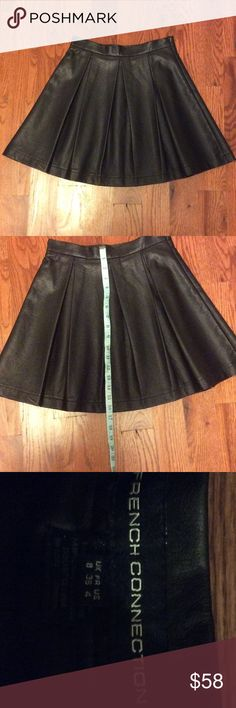 "French Connection Pleated Faux Leather Mini Skirt Faux leather and pleated mini.  Perfect condition.  Fully lined with black satin.  Side zipper. 26"" around waist and 16.5"" long French Connection Skirts Mini"