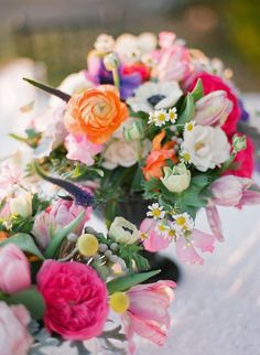 Bright Spring Floral Centerpieces | photography by http://www.justindemutiisphotography.com