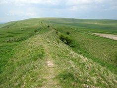 The Wansdyke. An early medieval defensive linear earthwork, runs from south of Bristol to near Marlborough, Wiltshire, passing not far from Bath. It probably was built in the fifth or sixth centuries, perhaps by Ceawlin (d. Son of Cynric of Wessex Anglo Saxon Kingdoms, Roman Roads, Fortification, British History, Adele, The Locals, Countryside, Britain, Country Roads