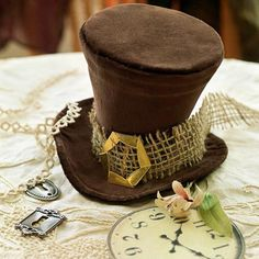 How to make a Mad Hatter hat, must make one!  Perfect for Alice in Wonderland Parties, Halloween, or when you just need a rather odd top hat!*