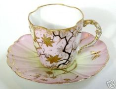 Limoges France Demitasse Cup & Saucer This auction is for a magnificent antique Limoges demitasse cup and saucer set from the Victorian era. These beautiful pieces feature a lovely stylized floral pa