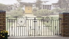 Ornate yet secure, these visually appealing iron gates would look amazing at the entrance of any traditional or period property