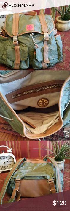 Tory Burch Tierney backpack New excellent condition no signs of use authentic slouchy water resistant Urban backpack, open side pockets secured with double pinch lock flap closure. silicone logo, patch leather trim, gold hardware, top drawstring closure, top handle strap adjustable back straps, exterior magnetic snap flap, slip pockets, lined interior zip wall pocket, 2 patch pockets, coated Tyvek, light on your back, hands free, great for students mom and baby retails for $325 Style TORYB…