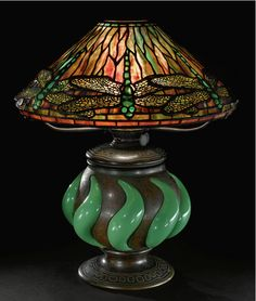 "A RARE ""DRAGONFLY"" TABLE LAMP  Estimate: 70,000 - 90,000 USD     leaded glass, favrile glass and patinated bronze circa 1900  Image: Sotheby's"