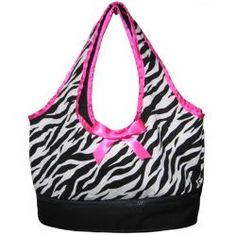 @Overstock - Your little girl will love this fashionable carrier and storage tote that is perfect for carrying your American Girl Dolls around. This zebra print bag fits two dolls and features zippered storage on the bottom to store clothing and accessories.http://www.overstock.com/Sports-Toys/AnnLoren-American-Girl-Dolls-Zebra-Doll-Tote/5471389/product.html?CID=214117 $24.49