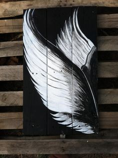 Handpainted angel wings on upcycled pallet boards. $55.00, via Etsy.