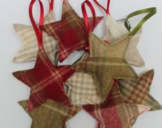 Gorgeous Christmas Tree decorations available in green, red or cream Abraham Moon tweed. Each tweed Christmas tree is stuffed with cloves (and wadding for shape) and finished with a cinnamon stick trunk. They smell like Christmas and make a lovely pre-Christmas gift, holiday decoration or stocking filler. The tree decorations are 8cm (3 1/4) wide at the tweed base and 11cm (4.5) high from the top of the tree to the base of the trunk. The ribbon loop is approximately 7cm (3) long. Please…