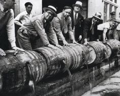 Draining barrels during the prohibition era in the US.