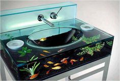 """Moody Aquarium Sink by Italbrass was created to define the mood in your bathroom. You can choose Moody to be an aquarium with gold fish or a terrarium with rocks and plants or a Zen garden with sand or a simple pebble river bed."""