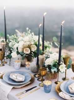 Moody blue and gold wedding theme - gorgeous wedding tablescape ,dark blue candles + white and green floral centerpieces
