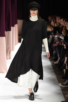 "Oversize scoop neck dress in draped black jersey. • Kimono sleeves • Perfect for layering • One size fits most • 100% Tencel • Made in Portugal Julia is 5'10"", small top, size 2 pant"