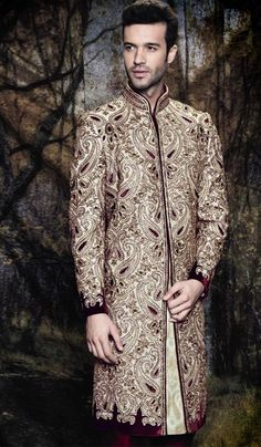 Captivate the essence of elegance as you adorn this sherwani for wedding occasions. This Royal designer masterpeice is luxuriously crafted with exclusive embroidery work allover in the front and sleeves along with a huge butta at the back. Wedding Dress Men, Wedding Men, Wedding Suits, Groom Wear, Groom Outfit, Indian Bridal Wear, Indian Wear, Punjabi Fashion, Indian Fashion