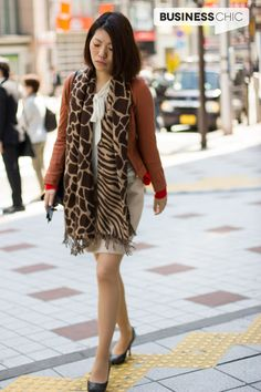 Business Chic woman works autumn colours- just check out the flash of red at the sleeves! via www.BusinessChic.com.au