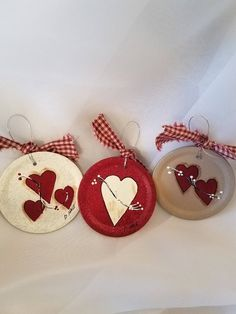Hearts and berries hand painted on metal canning jar flats. Signed and sealed with a homespun tie on a wire hanger. This listing is for 3 ornaments. Colors shown unless you request otherwise. These ornaments are made to order. Valentines Day Decorations, Valentine Day Crafts, Holiday Crafts, Jar Lid Crafts, Mason Jar Crafts, Canning Jar Lids, Mason Jar Lids, Diy Christmas Ornaments, Dog Ornaments