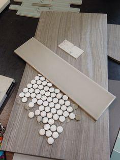 Tile for master bath: penny tiles for shower floor, large ceramic tiles for floor, and gray subway tile for shower.