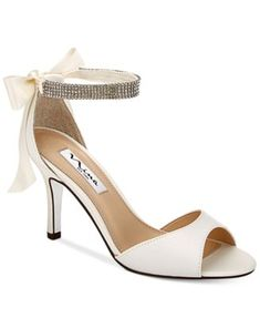 """These sparkling beauties are sure to turn some heads. The Vinnie two-piece evening sandals by Nina. 