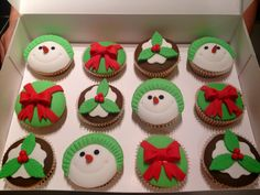 Snowman, present & Christmas pudding cupcakes.   (Double caramel flavored with a chocolate ganache & fondant topping.)