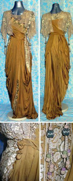 Evening dress, 1912, in mustard-colored silk. Lace inserts, polychrome silk embroidery, decorations and string tassel. Via Abito del Passato.