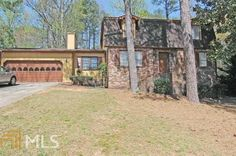 Located in the Pope District of Cobb County, this home has four beds and three baths. This home also features his and her walk in closets, a large fenced in back yard, fireplace in living room, an eat-in kitchen, and a full basement. This home has so much potential, you should check it out today! Click on the photo to learn more.