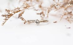 This beautiful solitaire design is both classic and rustic. Ring details- -Main stone is a 5mm white sapphire with lots of natural sparkle. -The band is molded from a real twig and then cast in your choice of solid 14k yellow, white or rose gold. -Prong has butterfly detailing which looks