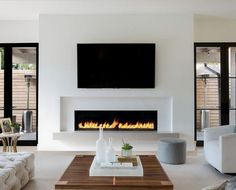 How about this black and white modern family room design? Coastal Virginia Magazine's Best Kitchen & Bathroom Remodeler - How about this black and white modern family room design? Coastal Virginia Magazine's Best Kitchen & Bathroom Remodeler - Living Room Decor Fireplace, Fireplace Remodel, Living Room Tv, Fireplace Tv Wall, Fireplace Ideas, Fireplace Modern, Linear Fireplace, Modern Electric Fireplace, Basement Fireplace