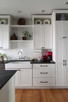 Design Sponge::boxes above cabinets, inexpensive way to extend floating cabinets.