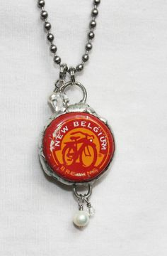 Vintage Beer Bottle Cap Necklace - New Belgium Brewing and Newcastle Brown Ale. $28.00, via Etsy.