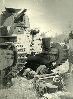 The Japanese soldier who takes a rest in the shade of the tank.  In Shanghai 1937.
