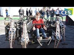 """Veronica Belmont Rides this solar powered giant robot spider at CES 2013. """"It's like driving a tank."""""""