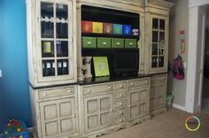 This is from Becky Higgins blog.  It is a piece in her playroom.  Love the look of it! Real furniture to organize toys??