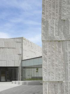 Spanish Zooco Estudio has completed a complex of granite-clad buildings in the city of Verín that come together to form an arts centre for the Galician region.