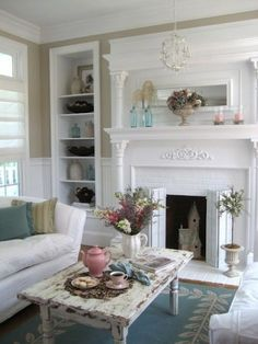 Cottage living room. I like the white fireplace surround with ornate designing.