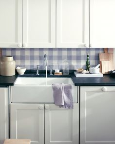 'Gingham' tiles - Martha Stewart.  Love this with the black bench and white cabinets - the visual focus is also where the action takes place