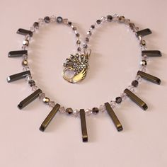Silver, Swarovski Crystal And Haematite Necklace With Graduated Beads