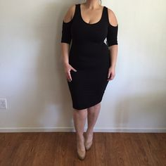 """Cold Shoulder Black Midi Dress* Dress Sz L. Brand New Without Tag  I don't trade or use PayPal please don't ask. All sales are final. All offers need to be made with the offer feature. Low ball offers will result in being blocked. Happy Poshmarking! For Reference: I'm 5'2"""" 34DDD Dresses Midi"""