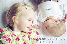 precious picture of newborn and big sister