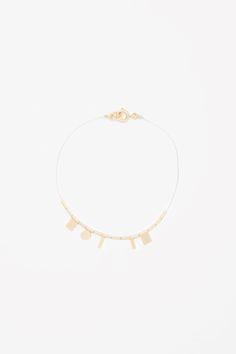 COS   Fine metallic string bracelet
