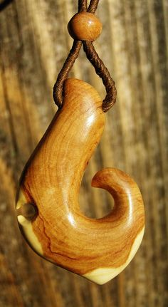"""Lilac Wood Carved Fishing Hook, 11/16"""" x 1 3/4"""" x 3/8"""" thick, with Carved 1/4"""" Lilac Wood Bead."""