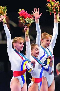 Andreea Raducan in middle, Simona Amanar on left, and Maria Olaru on right. 2000 Olympics ROM photo by gymnstands Gymnastics Posters, Gymnastics Workout, Gymnastics Pictures, Sport Gymnastics, Olympic Gymnastics, Olympic Games, Romanian Gymnastics, American Gymnastics, Acrobatic Gymnastics