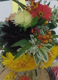 Dahlia,zinnia,sunflowers and euphorbia. Coral yellow centerpiece. www.shellysfloraldreams.com