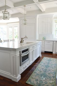 Bright White Kitchen with Cabinets to Coffered Ceiling & Subtle Blue & Green Accessories by Sita Montgomery Interiors