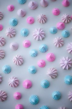 "Making meringues doesn't have to be complicated! You need just 3 piping bags with piping tips -- I used a plain, open circle tip for the hot pink classic ""kiss,"" a small multi-pronged open star tip for the blue kisses, and a jumbo open star tip for the pale pink. Recipe and tips here!"