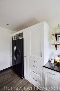 kitchen cabinets and black American style fridge freezer, custom built cabinets in the handmade kitchen Kitchen Layout, Diy Kitchen, Kitchen Decor, Kitchen Design, American Fridge Freezer Built In, Hidden Door Bookcase, Hidden Doors, Handmade Kitchens, Home Renovation