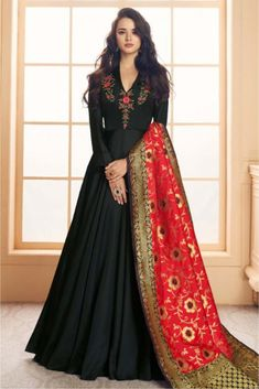 Black And Red Embroidered Satin Anarkali Suit is specifically designed to make you look perfect for wedding event or any festive occasions. This elegant set comprises a satin silk anarkali with nec. Indian Gowns, Pakistani Dresses, Indian Outfits, Designer Anarkali, Party Wear Evening Gowns, Casual Gowns, Dress Outfits, Fashion Dresses, Suit Fashion