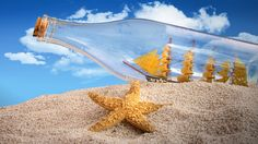 Bottle With Ship Inside On The Beach With Starfish wallpaper by