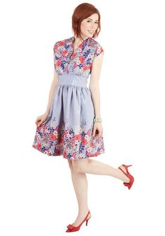 This floral dress from Myrtlewood offers the perfect way to stand out in a crowd on Friday night! With its pale lilac hue and cascading flower pattern of white, orchid, vibrant coral, and indigo, this retro frock - found exclusively at ModCloth - exudes artsy appeal.