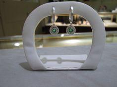 White gold dangle earrings with filigree, emerald centers! www.singingjeweler.com